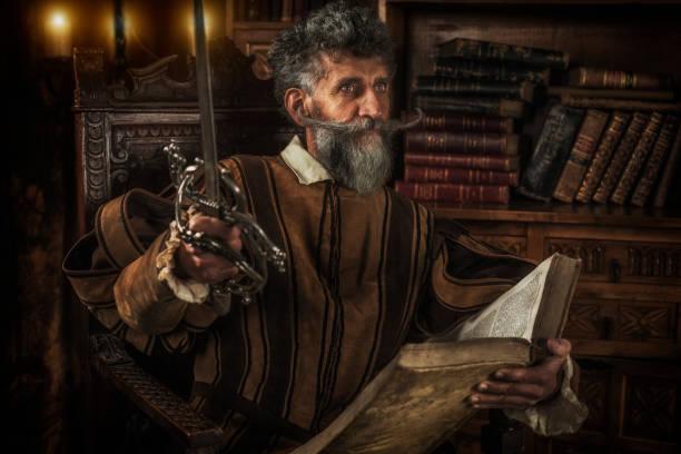 don quijote förlora sitt sinne när du läser ridderlighet böcker - celebrities of age bildbanksfoton och bilder