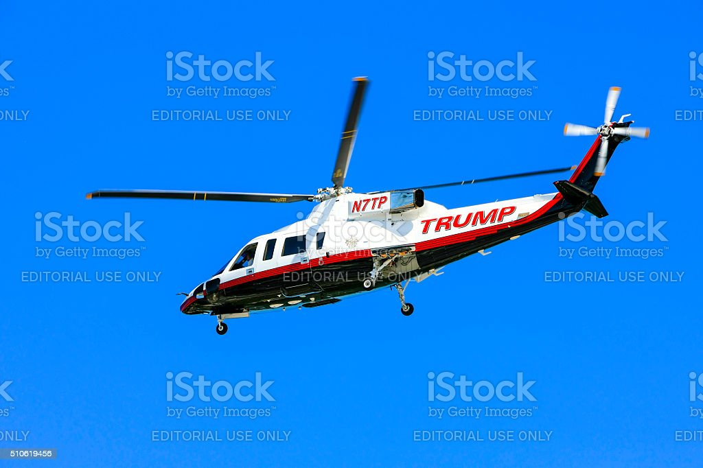 Donald Trump's personal Sikorsky S-76 helicopter flying over Sarasota FL stock photo