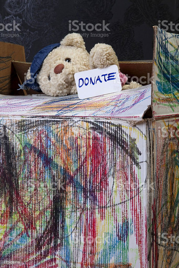 donate box with teddy bear,detail royalty-free stock photo
