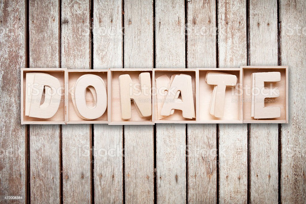 Donate wood word style stock photo