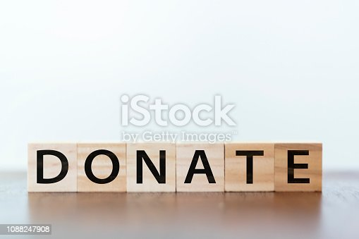 Donate word written on wooden cubes