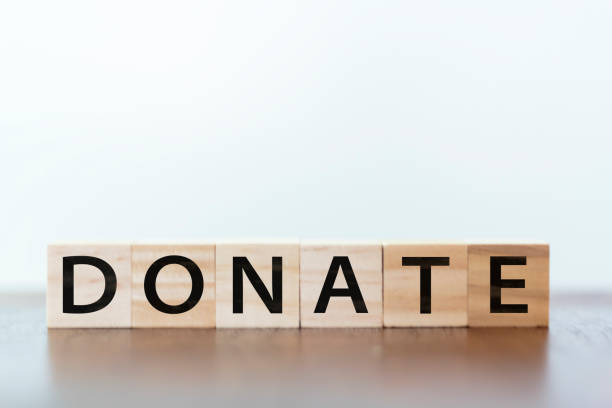 donate word written on wooden cubes - blood donation stock pictures, royalty-free photos & images