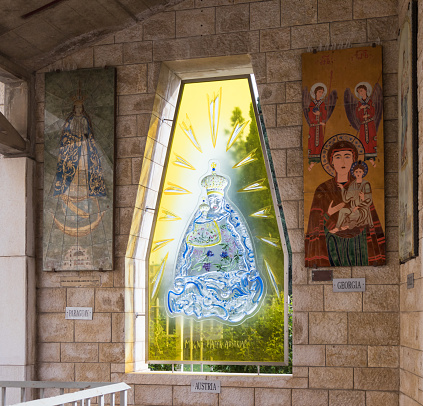 istock Donated icons on the walls in the courtyard of the Basilica of the Annunciation in the old city of Nazareth in Israel 904185820