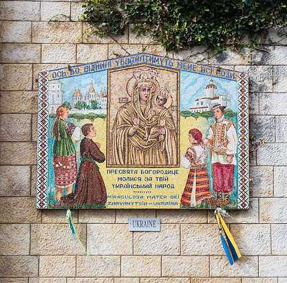 istock Donated icons on the walls in the courtyard of the Basilica of the Annunciation in the old city of Nazareth in Israel 904187194