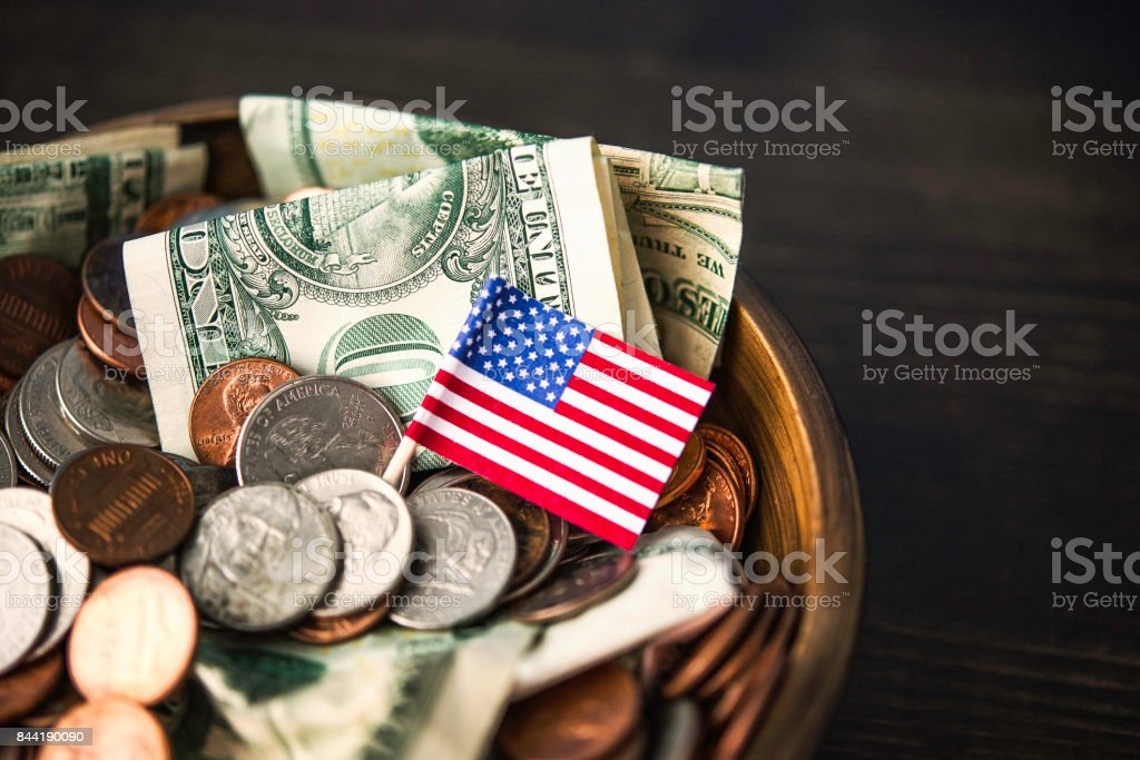 Donation bowl filled with cash. Charity and donation theme Donation bowl filled with cash. Charity and donation theme A Helping Hand Stock Photo