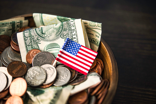 Donation Bowl Filled With Cash Charity And Donation Theme Stock Photo - Download Image Now