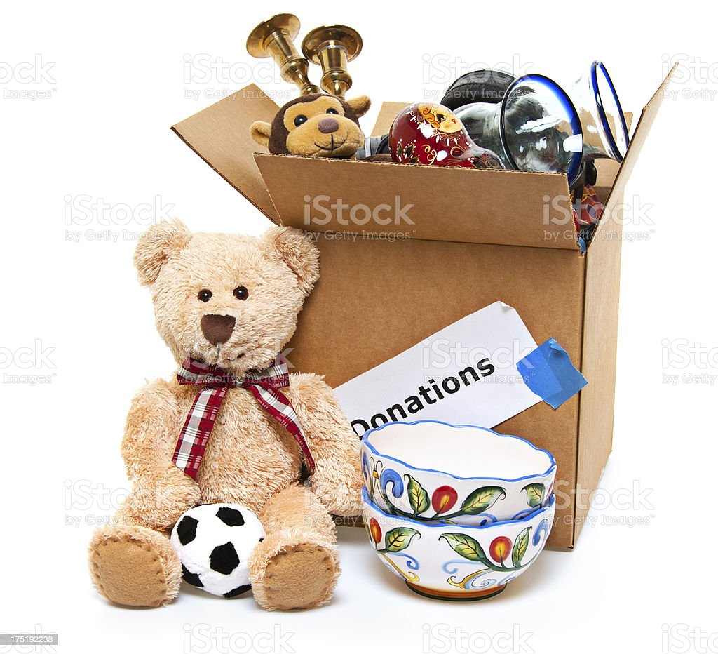 Donation Box Full of Toys, Books and Household Items stock photo