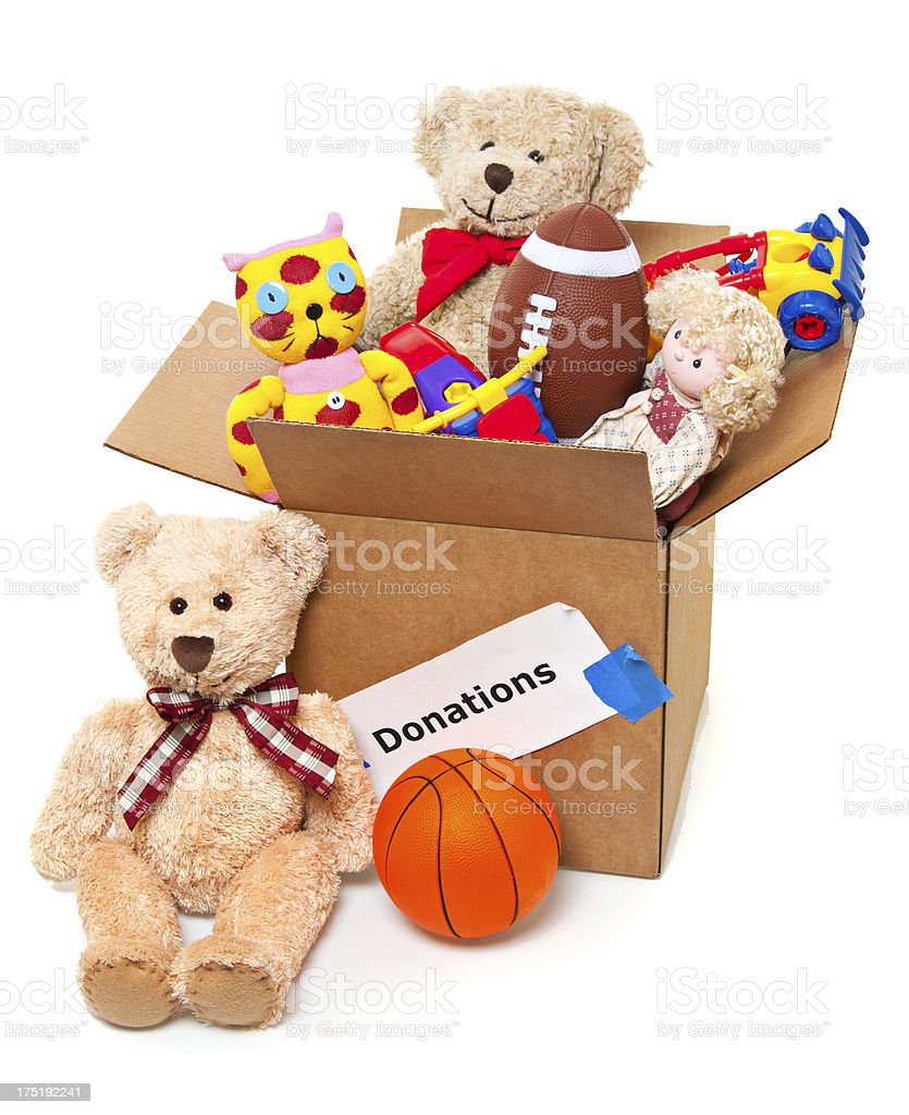 Toys For Donation : Donation box full of toys books and household items stock