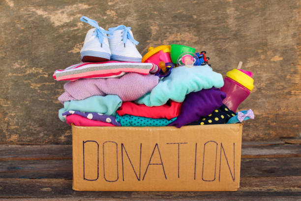 Donation box with children's things and toys stock photo