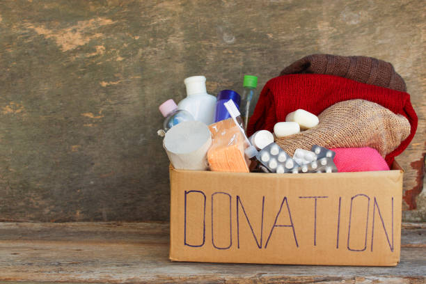 Donation box with clothes, living essentials stock photo