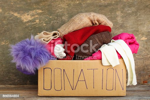 istock Donation box with clothes. 856564654