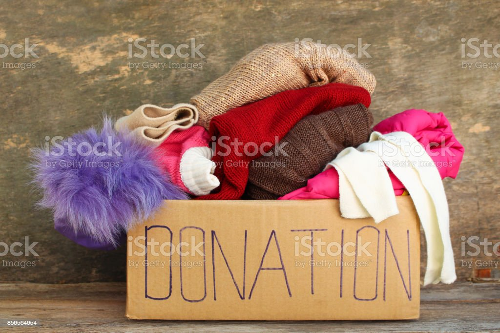 Donation box with clothes. stock photo
