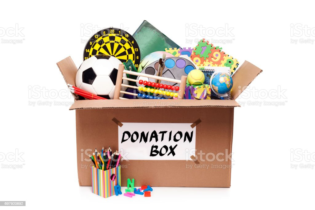 Donation box with toys and school supplies stock photo
