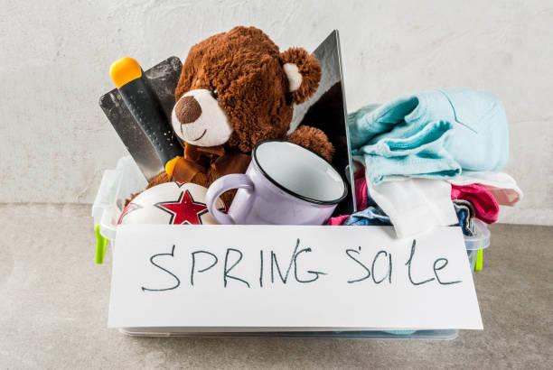 donation box with toys, clothes and food - oggetti personali foto e immagini stock