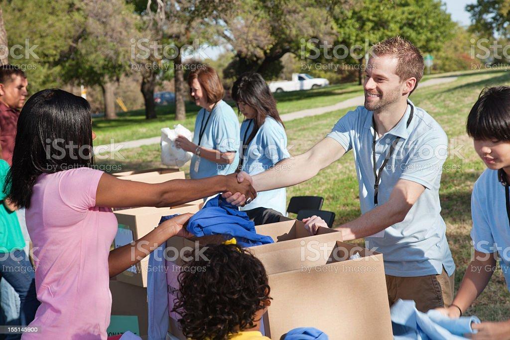 Donation center volunteer thanking donator royalty-free stock photo