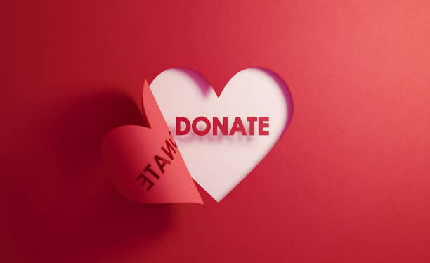 Donation Concept- Donate Text Inside Of A Red Folding Heart Shape On White Background Donate text inside of a red folding heart shape on white background. Horizontal composition with  copy space. Donation concept. charitable donation stock pictures, royalty-free photos & images
