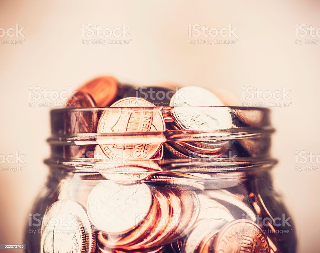 Donation jar overflowing with money stock photo