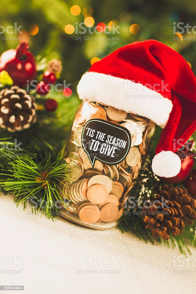 Christmas Charities.Donation Money Jar With Santa Hat For Christmas Charities