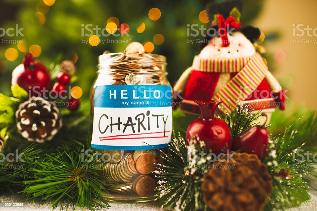 Christmas Charities.Donation Money Jar With Snowman Ornament For Christmas