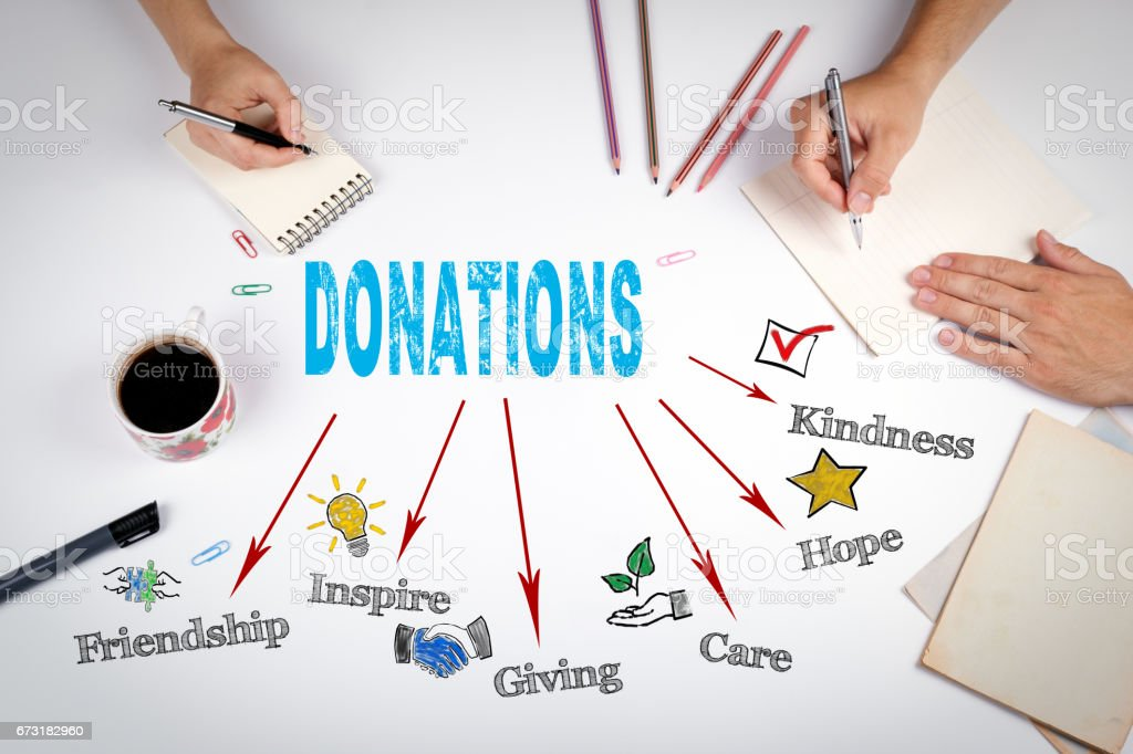 Donations Concept. The meeting at the white office table stock photo