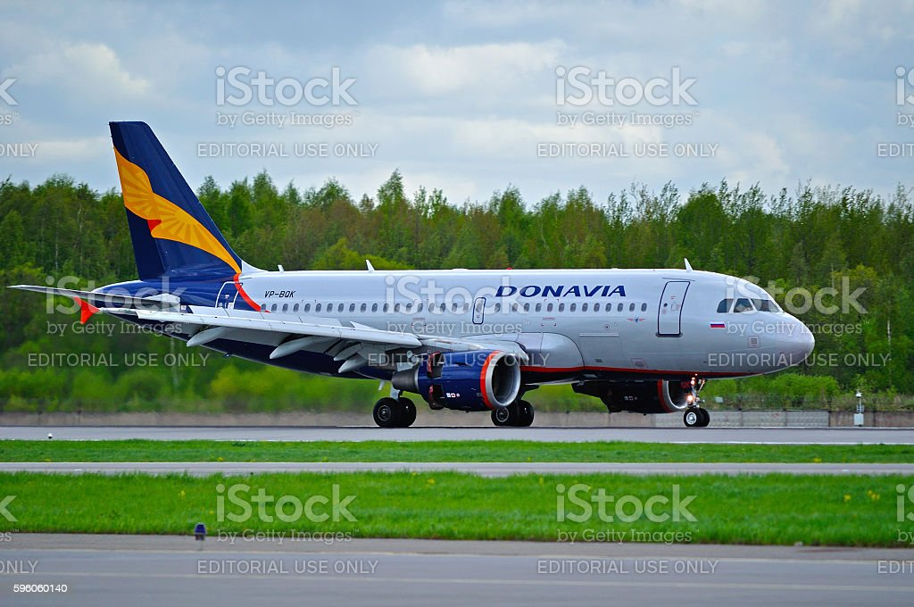 Donavia Airbus A319-111 airplane rides on the runway after landing royalty-free stock photo
