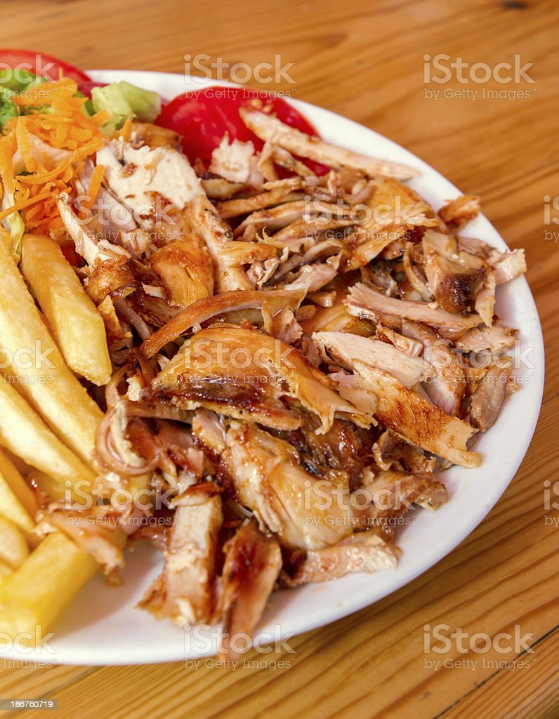 Doner Kebab dish with french fries stock photo