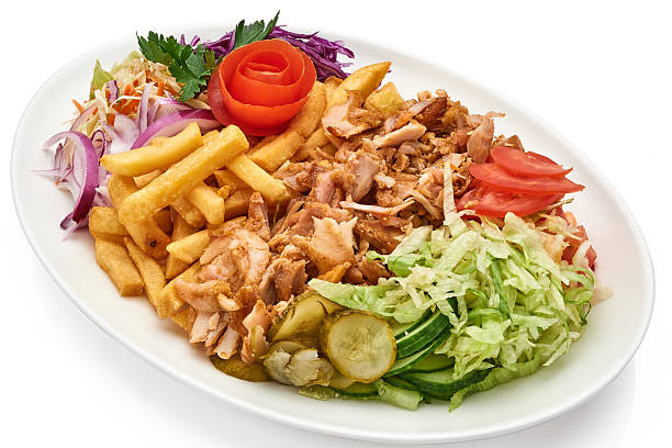 Doner kebab on a plate with french fries and salad stock photo
