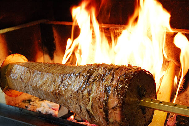 Doner Kebab (Pressed lamb roasted on a large horizontal spit)  spit roasted stock pictures, royalty-free photos & images