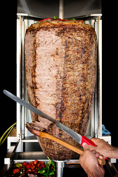 Doner Hands cutting doner kebab. spit roasted stock pictures, royalty-free photos & images