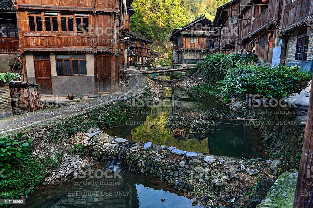 Dong ethnic minority village, wooden houses, river and dams, China. stock photo
