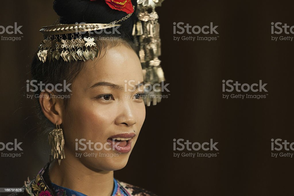 Dong girl singing in traditional clothes stock photo