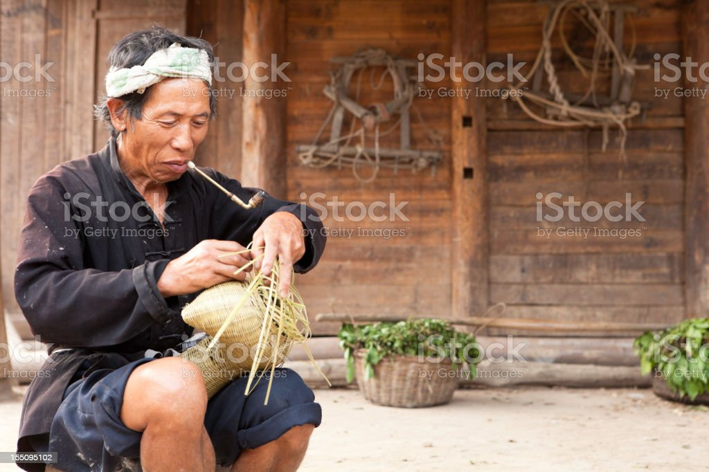 Dong Tribe Farmer Making Fishing Basket stock photo