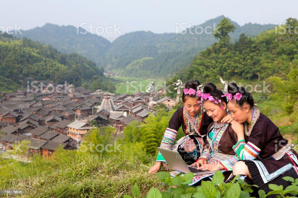 Dong Tribe Girls Using Laptop stock photo