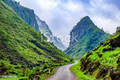Road through dramatic limestone scenery in the Dong Van Geopark, Vietnam