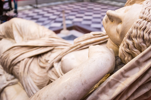 Florence, Italy - December 22, 2017: Leonardo Da Vinci statue, by Luigi Pampaloni, 1839. It is located in the Uffizi courtyard, in Florence.