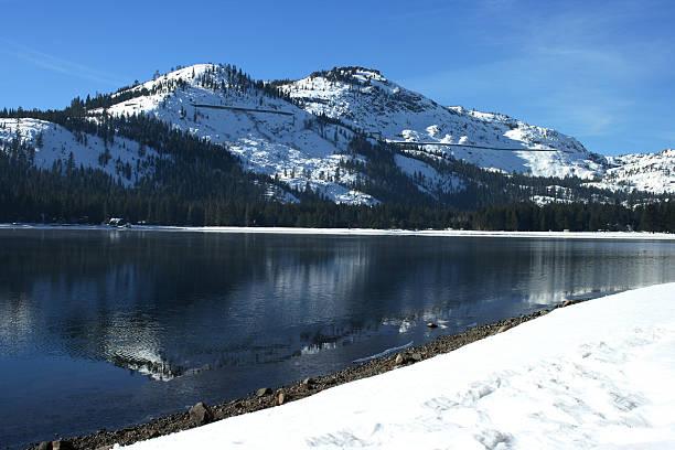 see donner lake - lake tahoe winter stock-fotos und bilder