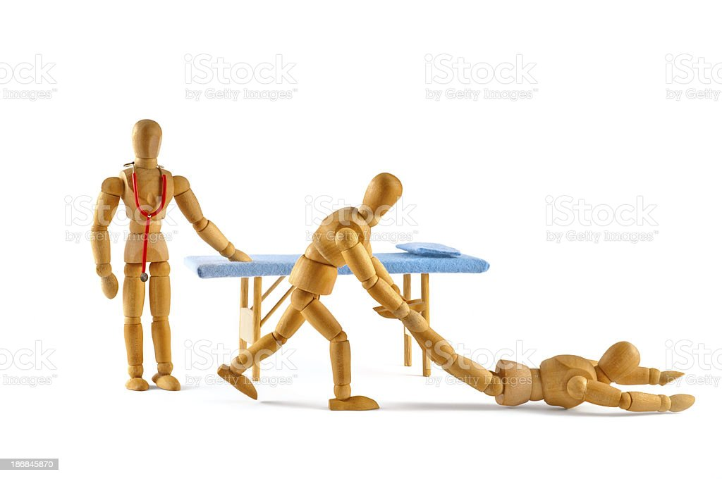Don't be like that! wooden mannequins at doctor royalty-free stock photo
