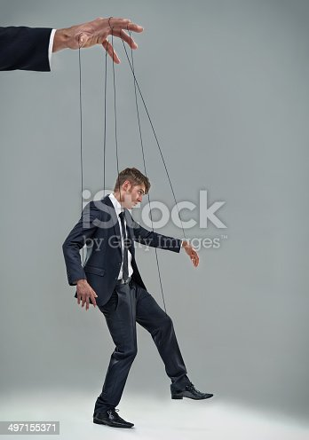 A businessman being controlled like a puppethttp://195.154.178.81/DATA/i_collage/pi/shoots/783268.jpg