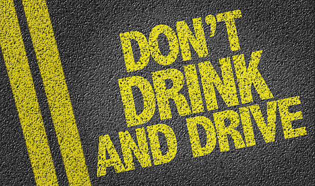 Don't Drink and Drive written on the road stock photo