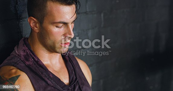 Shot of a young man looking unhappy after his workout at a gym
