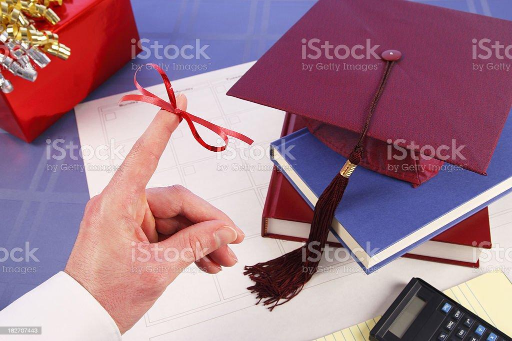 Don't Forget Finger Ribbon: Graduation, Cap, Books, Gift stock photo