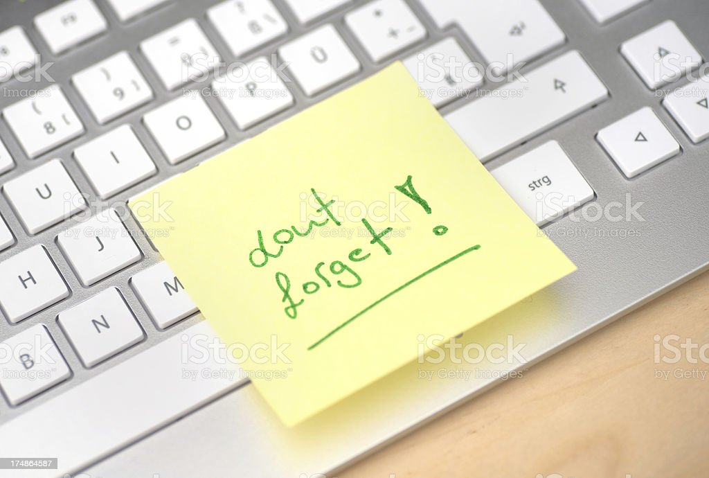 dont forget post-it memo on computer keyboard royalty-free stock photo