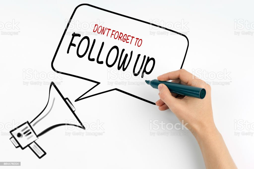 Don't Forget to Follow Up. Megaphone and text on a white background stock photo