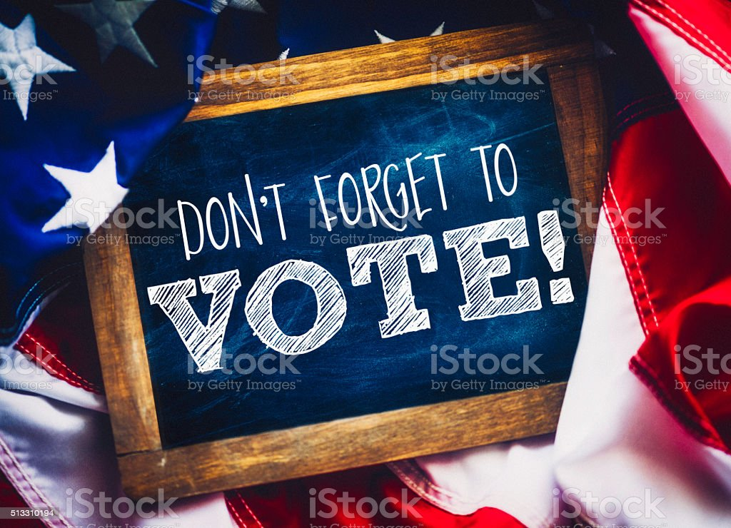 Don't forget to vote! Reminder on chalkboard to vote stock photo