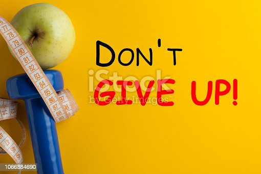 Don't Give Up. Motivational fitness quote. Concept sport, diet, fitness, healthy eating.