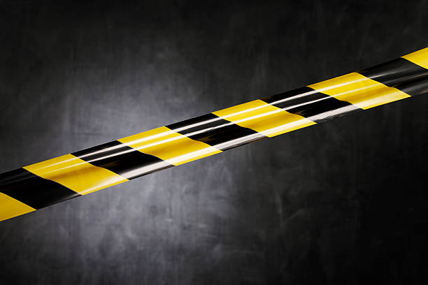 Don't go there Black and yellow plastic barrier tape blocking the way. affix stock pictures, royalty-free photos & images