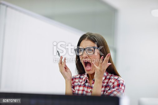 Shot of a young design professional looking frustrated while sitting at her computer