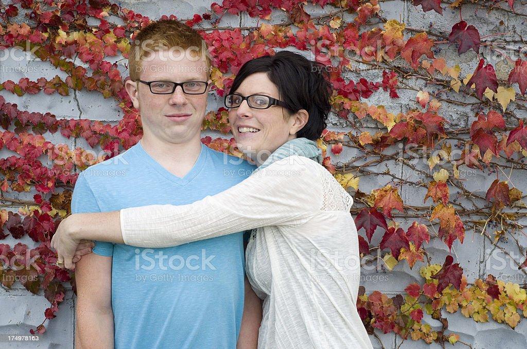 don't hug me, mom! stock photo