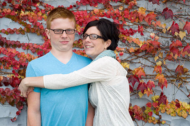 don't hug me, mom! Teen boy refuses to hug his mom back embarrassment stock pictures, royalty-free photos & images