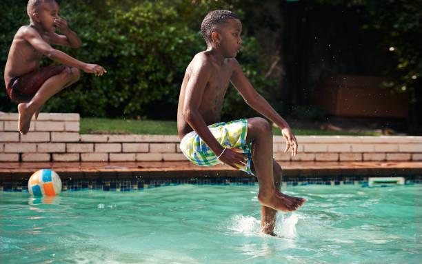 don't keep calm, it's summer! - jump pool, swimmer imagens e fotografias de stock